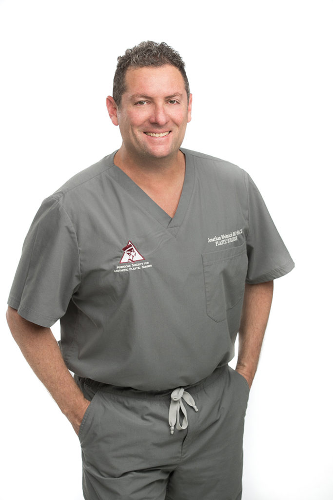 Scottsdale plastic surgeon Dr. Weinrach in gray scrub suit (larger)
