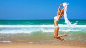 women in white bikini on the beach